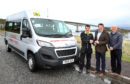 Michael Taylor, Chairman of Kyleakin Community Minibus Group, receives the keys from Marine Harvest's Kevin O'Leary and councillor John Finlayson