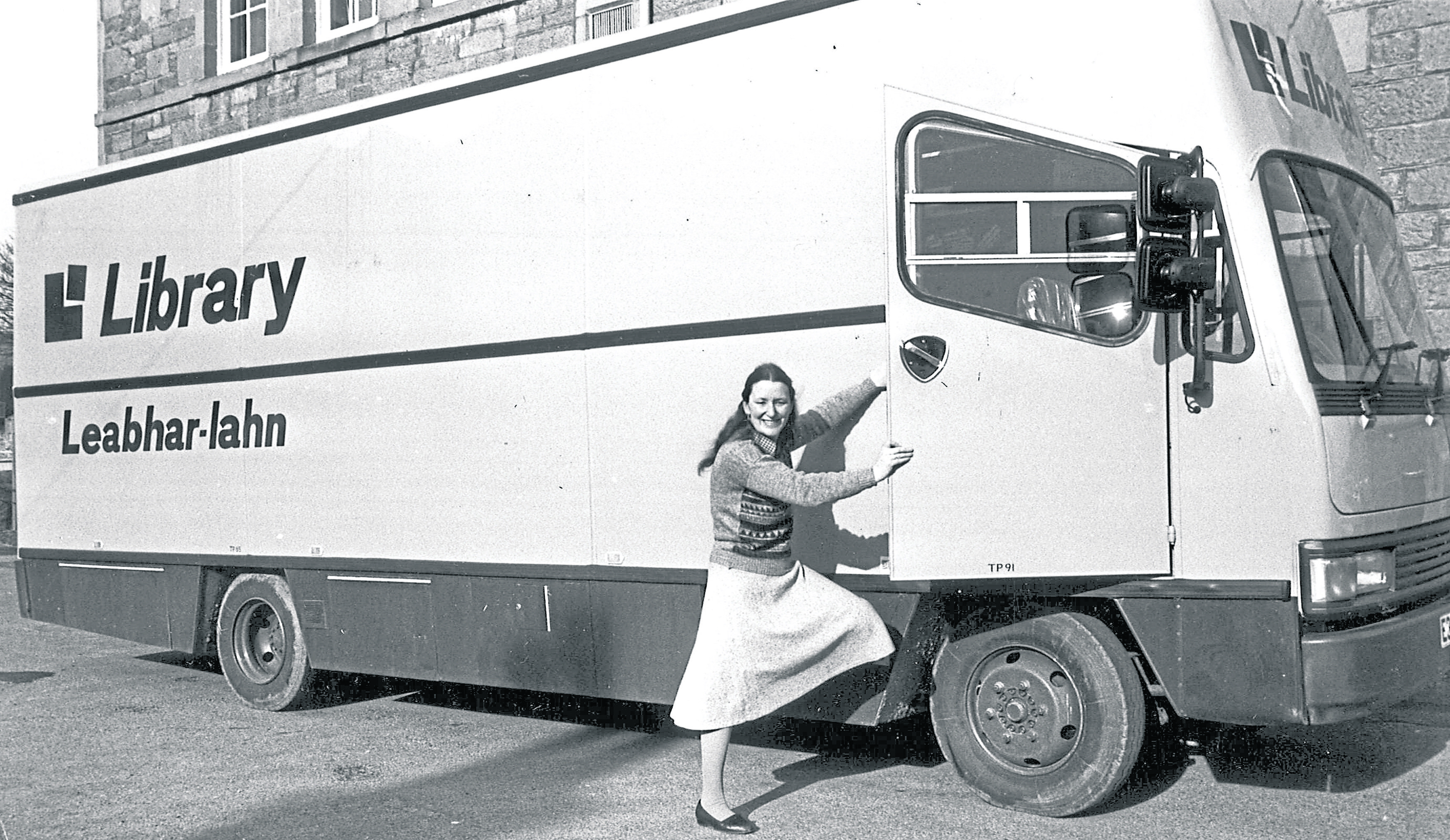 Mary Buchanan prepares to get into a mobile library, ready for another day spent calling at homes in the Black Isle in March 1988