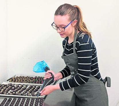 Cara Nixon making some chocolates.