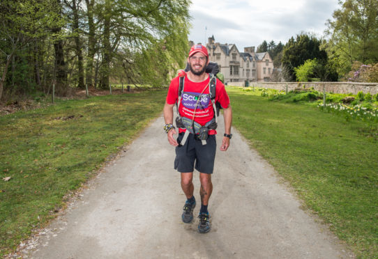 Chris Shipley who is currently running around the coast line of the UK running near Brodie Castle in Moray.