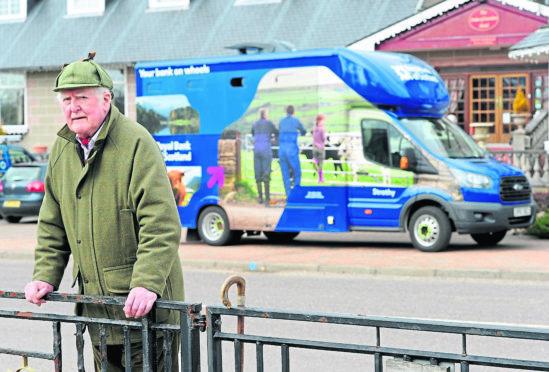 Joe Taylor, Kingussie Community Council Chairman outside the Royal Bank of Scotland van.