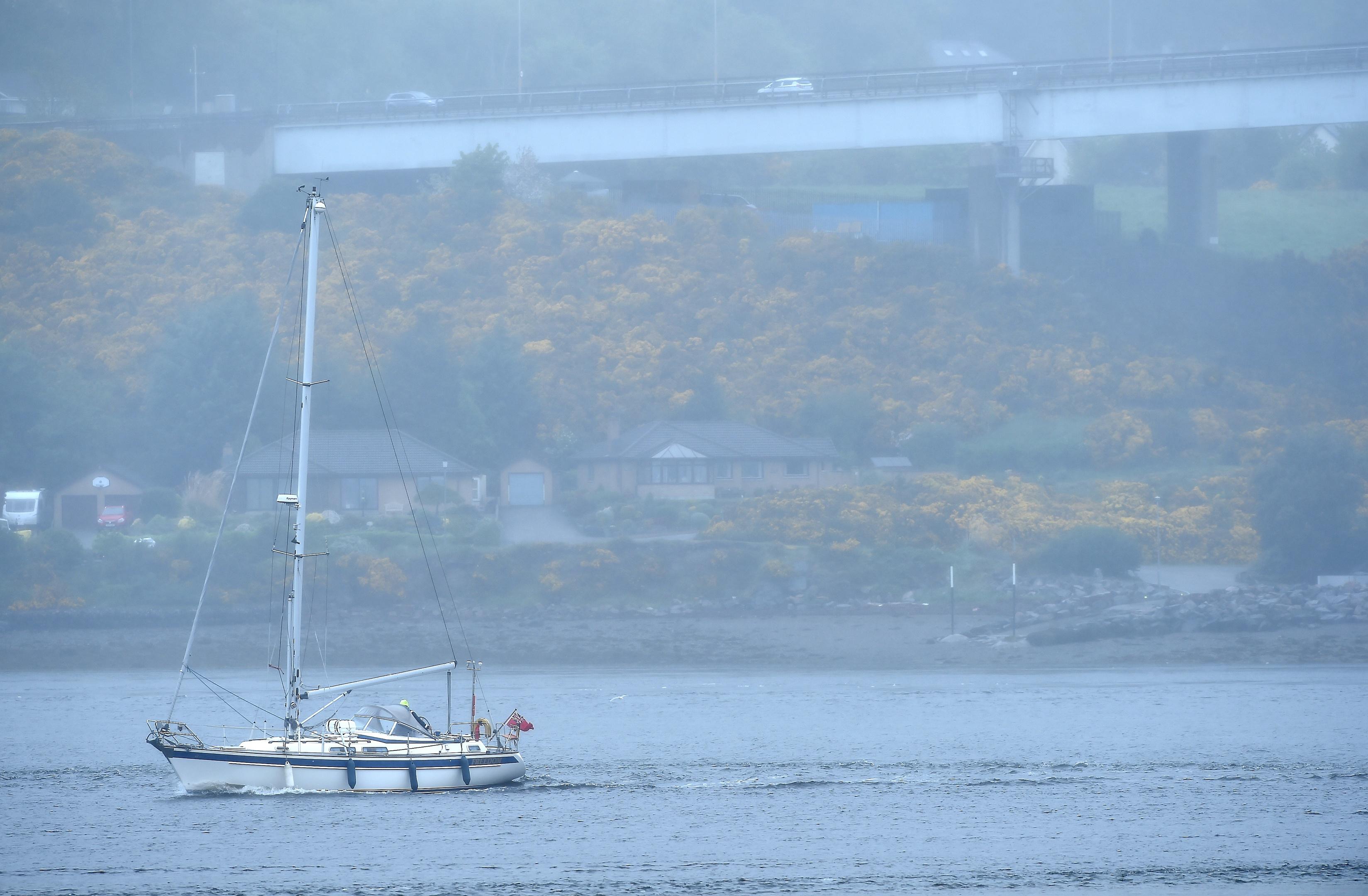 The yacht making its way past the Kessock Bridge.