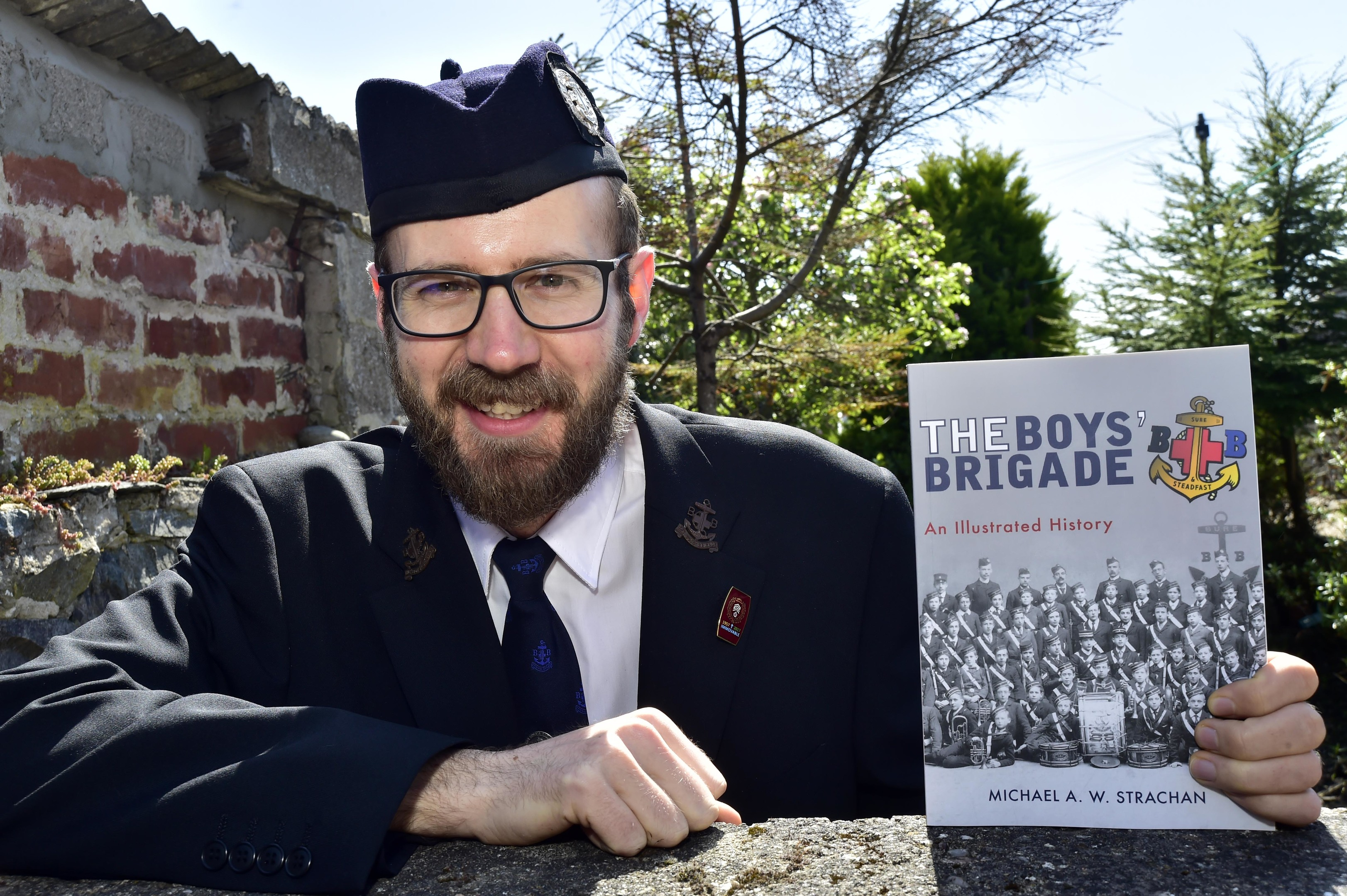 Michael Strachan with his illustrated history of the Boy's Brigade.