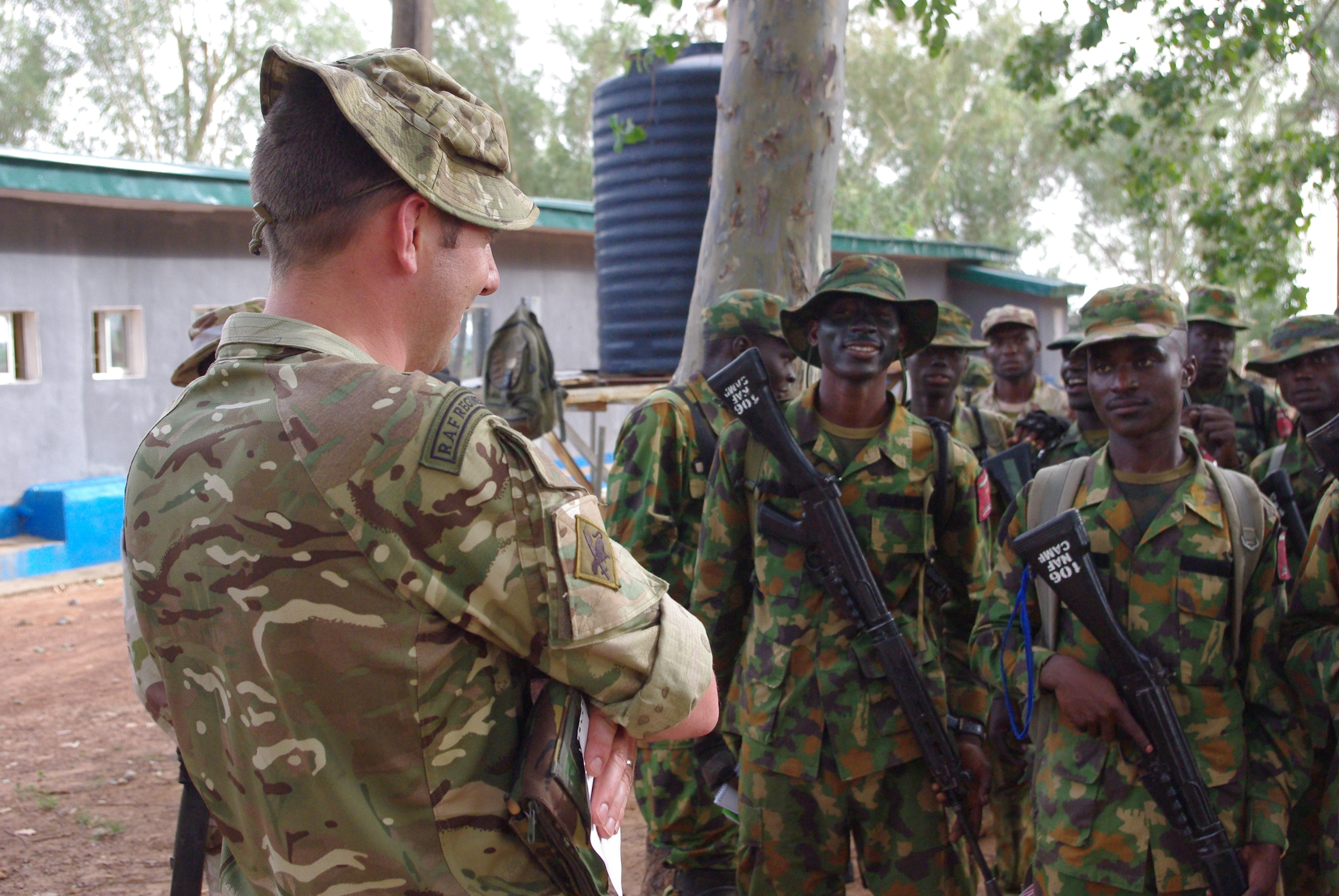 Corporal Thomas addresses the Nigerian troops.