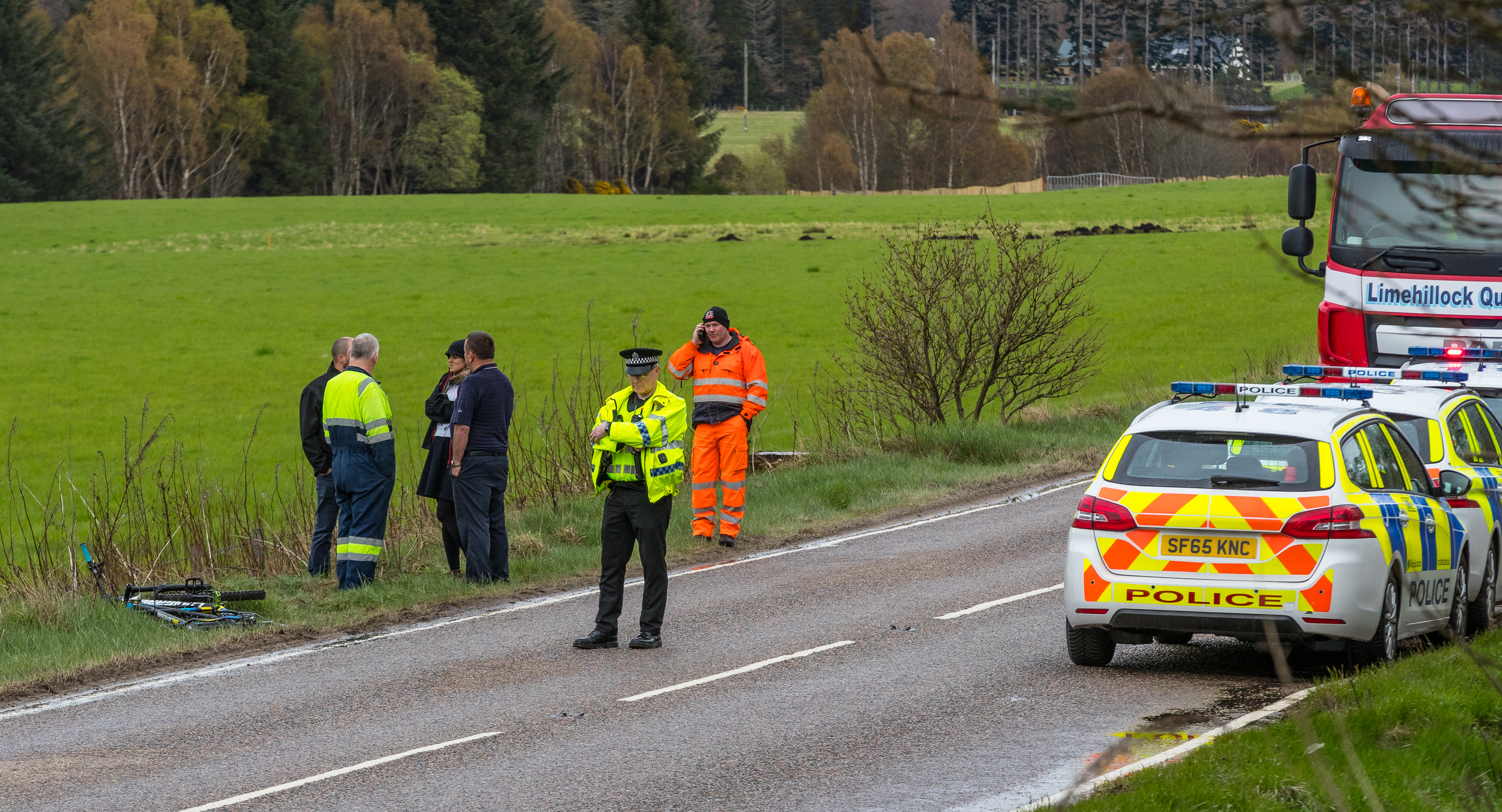 Emergency responders at the scene of the accident near the trout  fishery at Glen of Rothes on the A941 Craigellachie to Elgin road yesterday