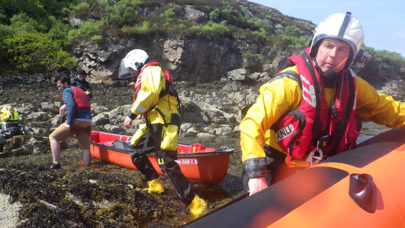 Kyle lifeboat crew assisting the family after they got into difficulty