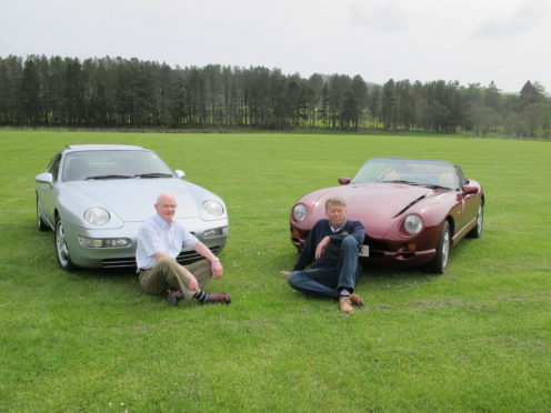 Crathes Vintage Car Rally organising committee chairman Stewart Park, with his 1994 Porsche 968 Sport sits on the grass with past president Richard Bridger and his TVR Chimacra 450