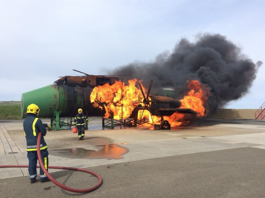 Firefighters in action at  Kirkwall Airport.