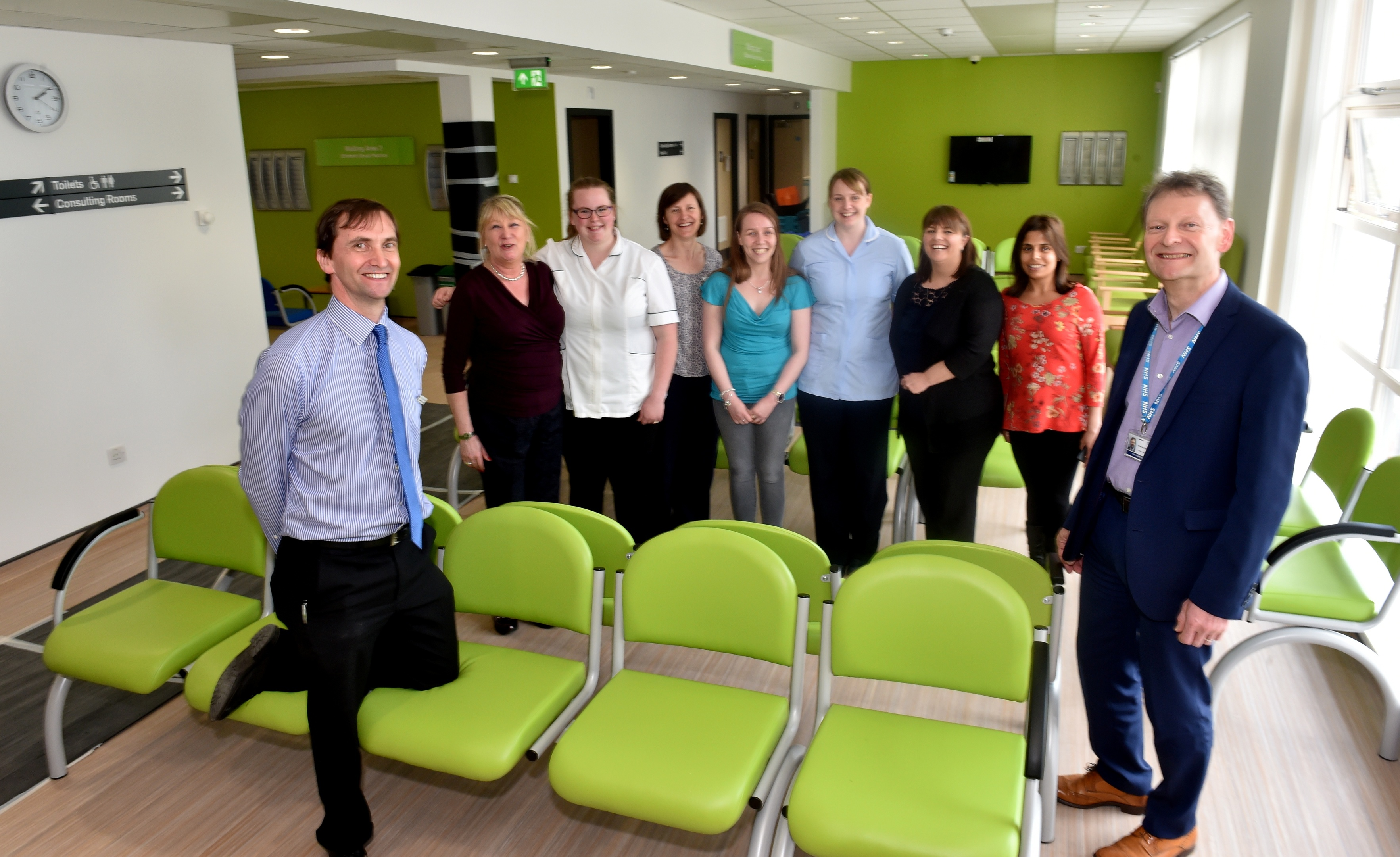 Dr Chris Provan (left) and project director Stan Mathieson (right) with staff at Foresterhill Health Centre. Picture by Colin Rennie