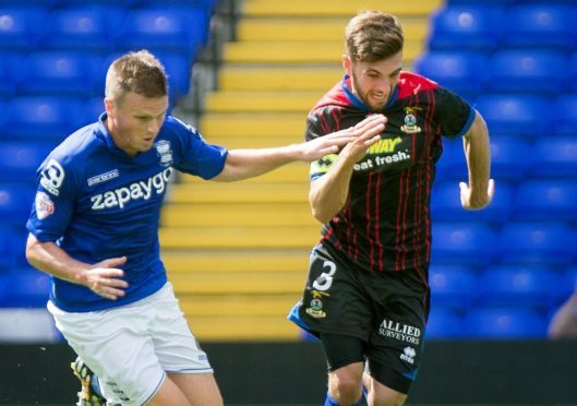 Stephen Gleeson takes on Graeme Shinnie in a pre-season friendly against Caley Thistle in 2014.