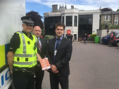 Sergeant Simon Lewis-Dalby, Detective Constable Mark Eddie and Grant Pinnell, from Aberdeen's fraud unit