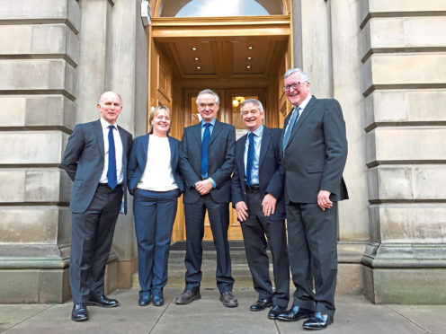 Rural Economy Secretary, Fergus Ewing, on the right, with the four agriculture champions. These are from left to right - Archie Gibson, Marion MacCormick, Henry Graham and John Kinnaird.