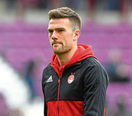 Aberdeen's Mikey Devlin  is in a race to be fit for the Betfred Cup final.