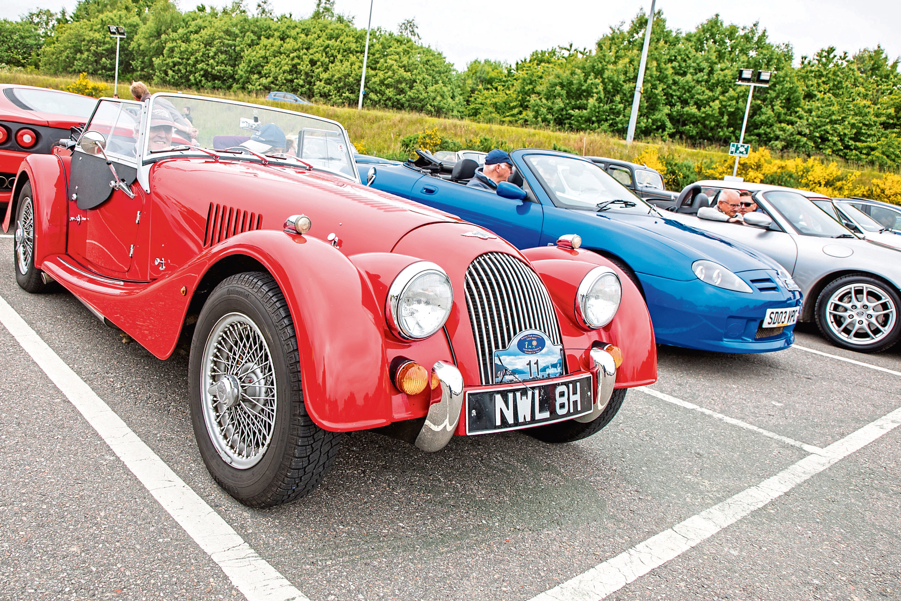 Classic cars line up before the start of the event
