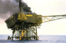 The remains of Piper Alpha smouldering on July 8 1988.