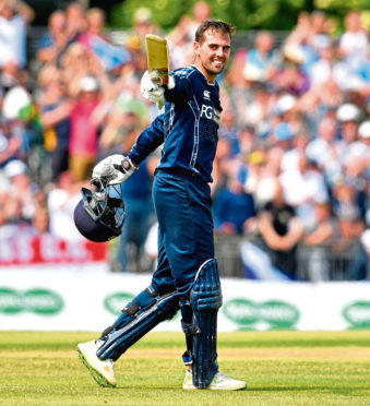 Calum MacLeod celebrates his century against England during Scotland's historic victory at the Grange, a win that lifted the game in Scotland.