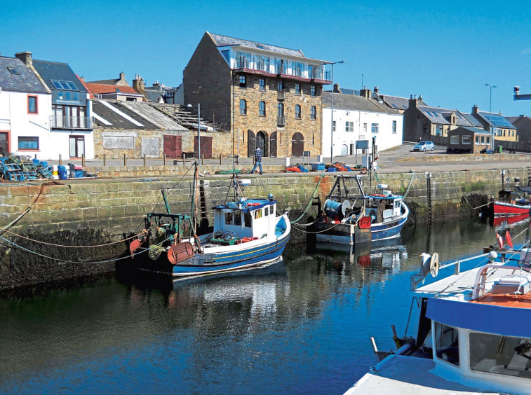 The attrative harbour in the village of Burghead near Lossiemouth on The Moray Firth on Scotland's North East Coast.