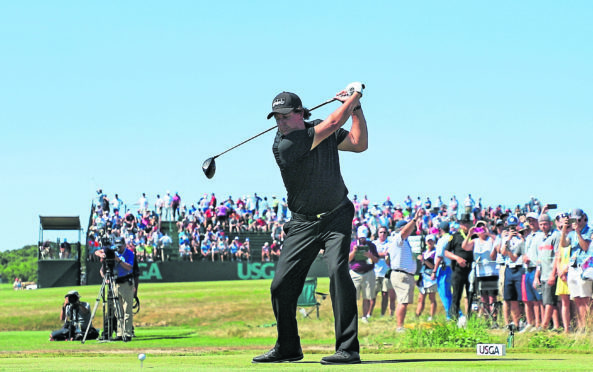 Phil Mickelson plays his shot from the eighth tee during the final round of this years US Open.