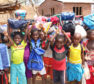 Children receiving backpacks from the Mary's Meals Foundation