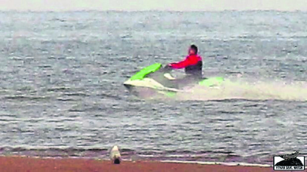 Pictures have emerged of two people jet skiing in the Ythan Estuary
