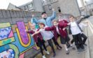 Artist Supermundane (Rob Lowe) launched the Look Again festival with the help of some local youngsters.