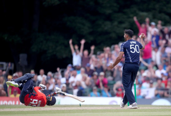England's Adil Rashid being run out during the One Day International at The Grange, Edinburgh. Photo: Jane Barlow/PA Wire
