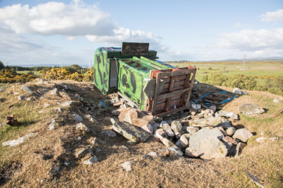 What appears to be a bird watching hide was installed on top of an ancient chambered cairn