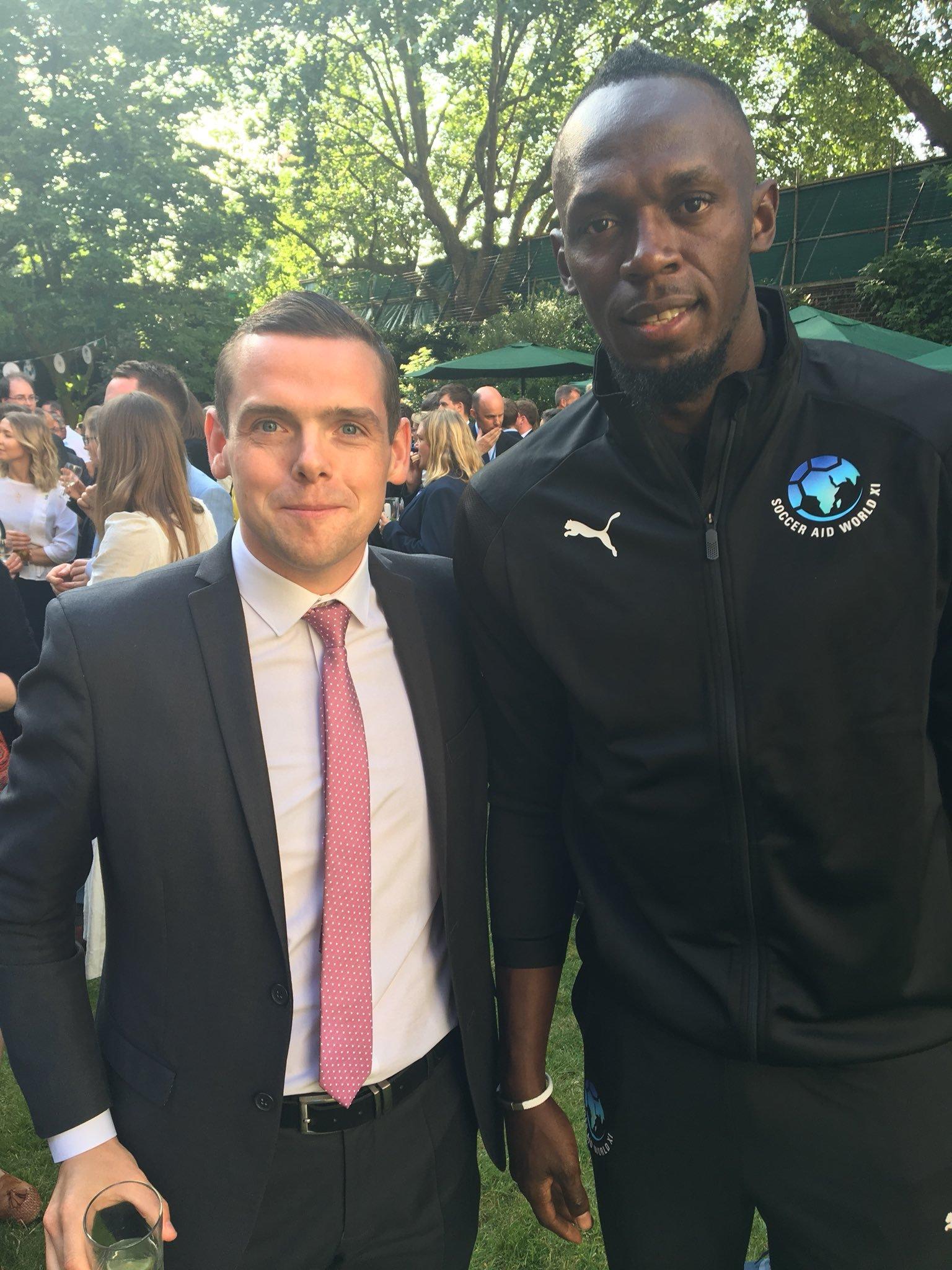 MP Douglas Ross with Usain Bolt