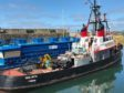 The seaman in his 70s was trapped between the tug Goliath and the blue fish farm feeder at Macduff