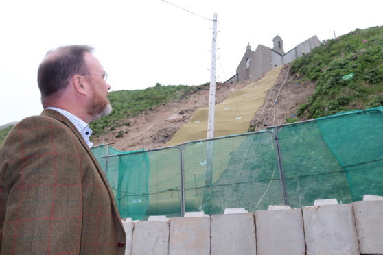 David Duguid MP at the temporary landslip repair at Gardenstown