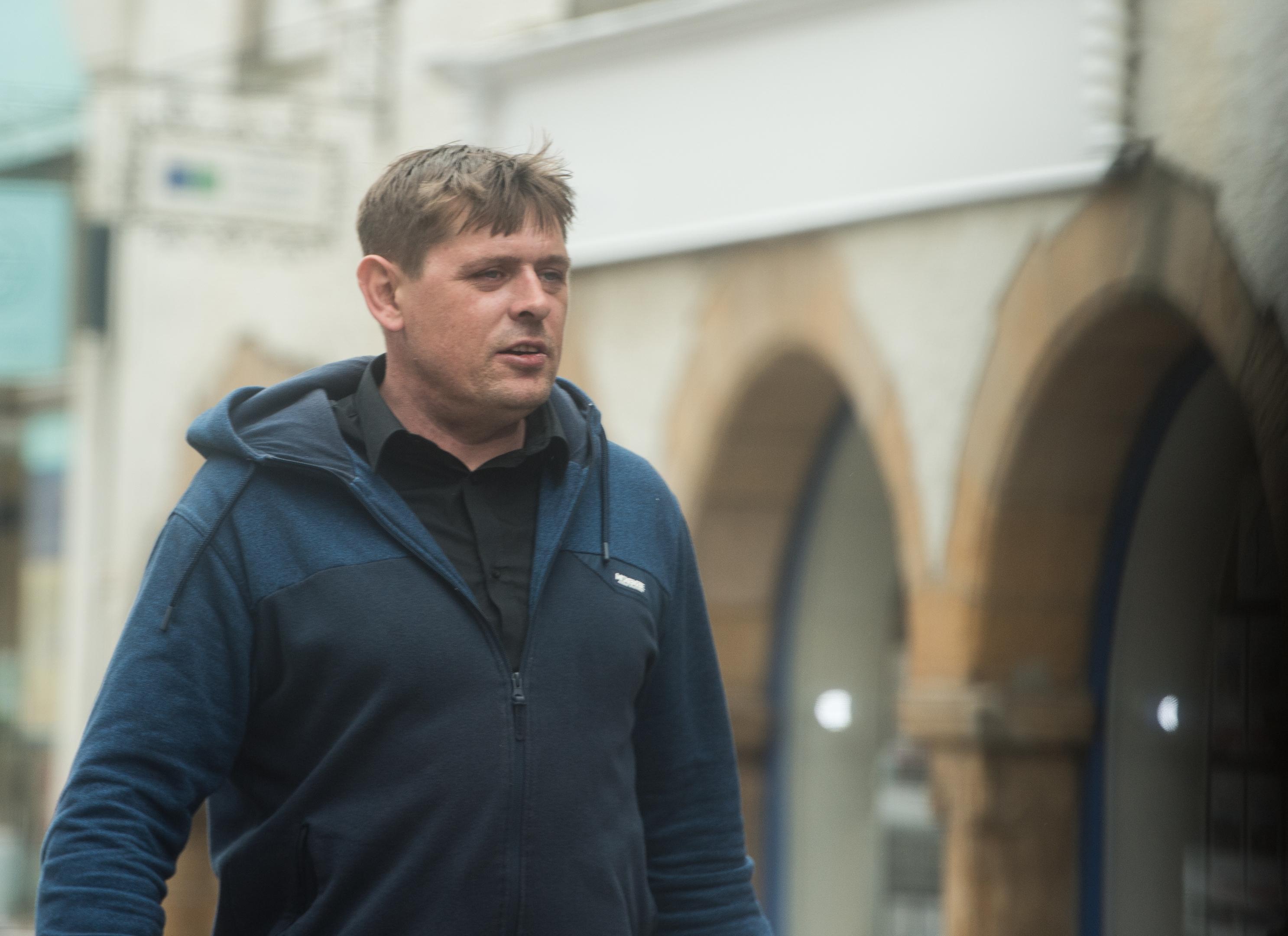 Ian Wilcox leaving Elgin Sheriff Court.