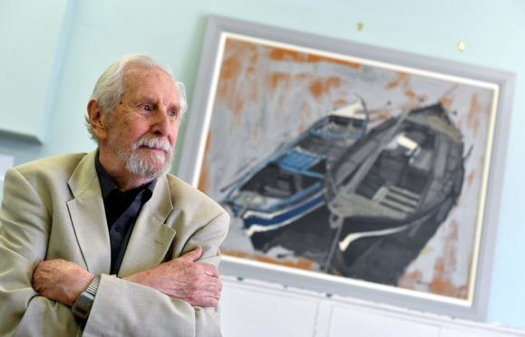 Artist James Morrison re-dedicated his fishing boat painting that has hung in Catterline School for decades.       (Picture by Kami Thomson)