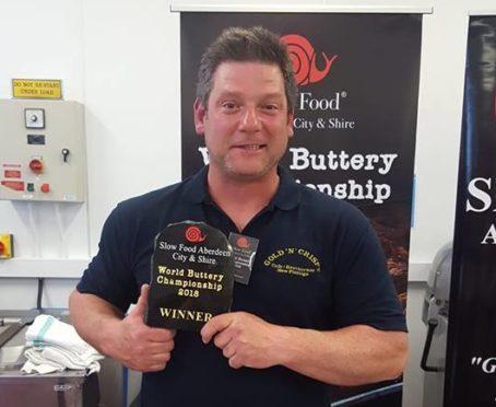 Mark Barnett with his award