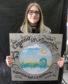 Millburn pupil Anna-Evalina holding the prototype for the HighlandAR Nessie plaque