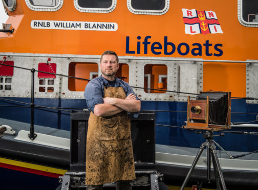 Wet Plate photographer Jack Lowe from the Lifeboat Station Project at Buckie Lifeboat station.