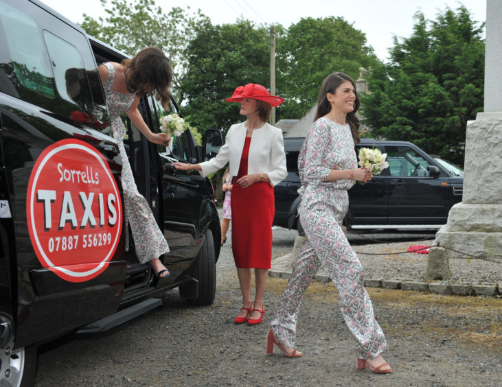 Bridesmaids and Rose Leslie's mum, Candida Leslie, arrive at the ceremony