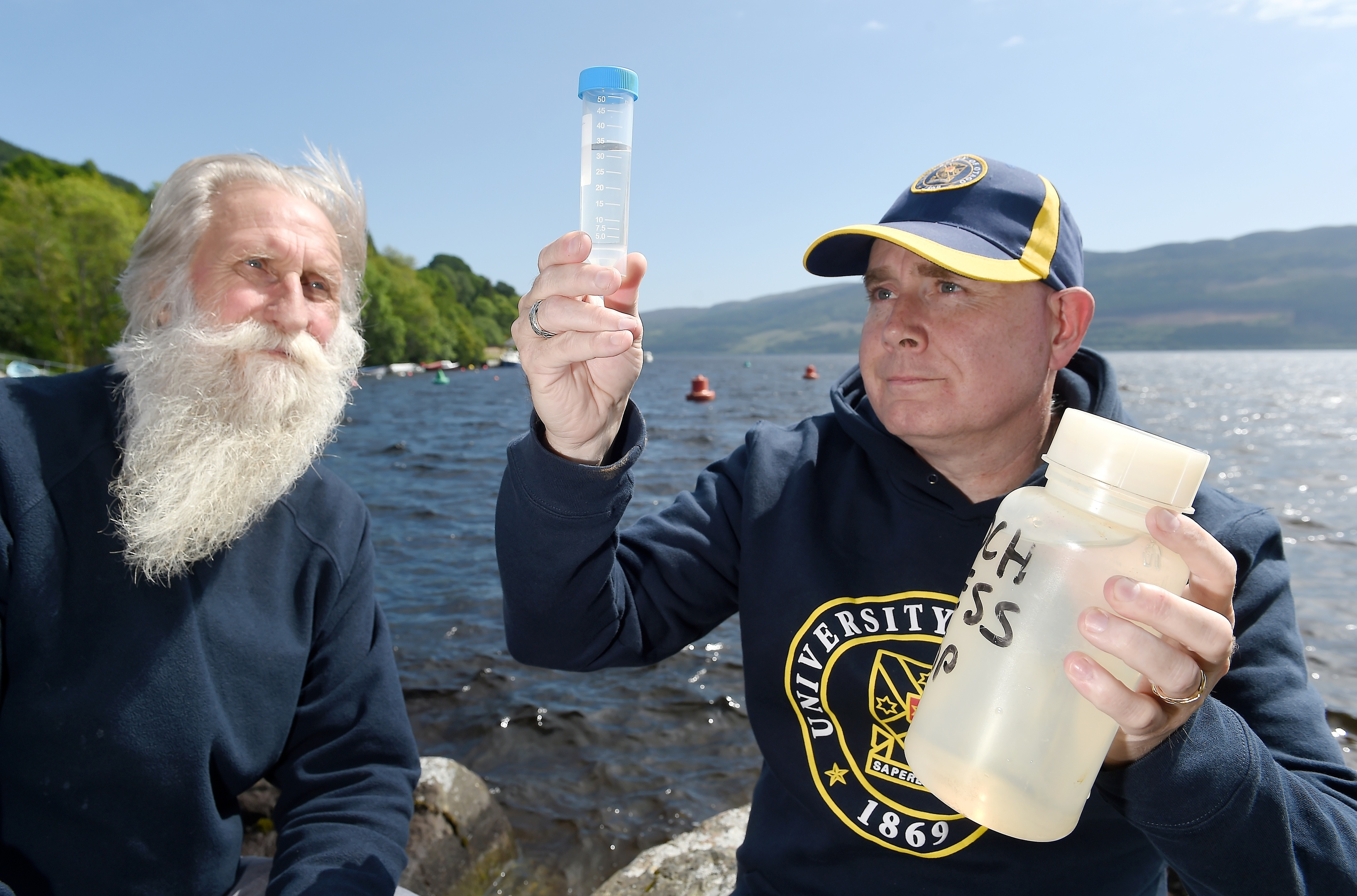 Professor Neil Gemmell of the University of Otago, New Zealand and Adrian Shine of the Loch Ness Project with water samples containing DNA which might lead to the discovery of Nessie