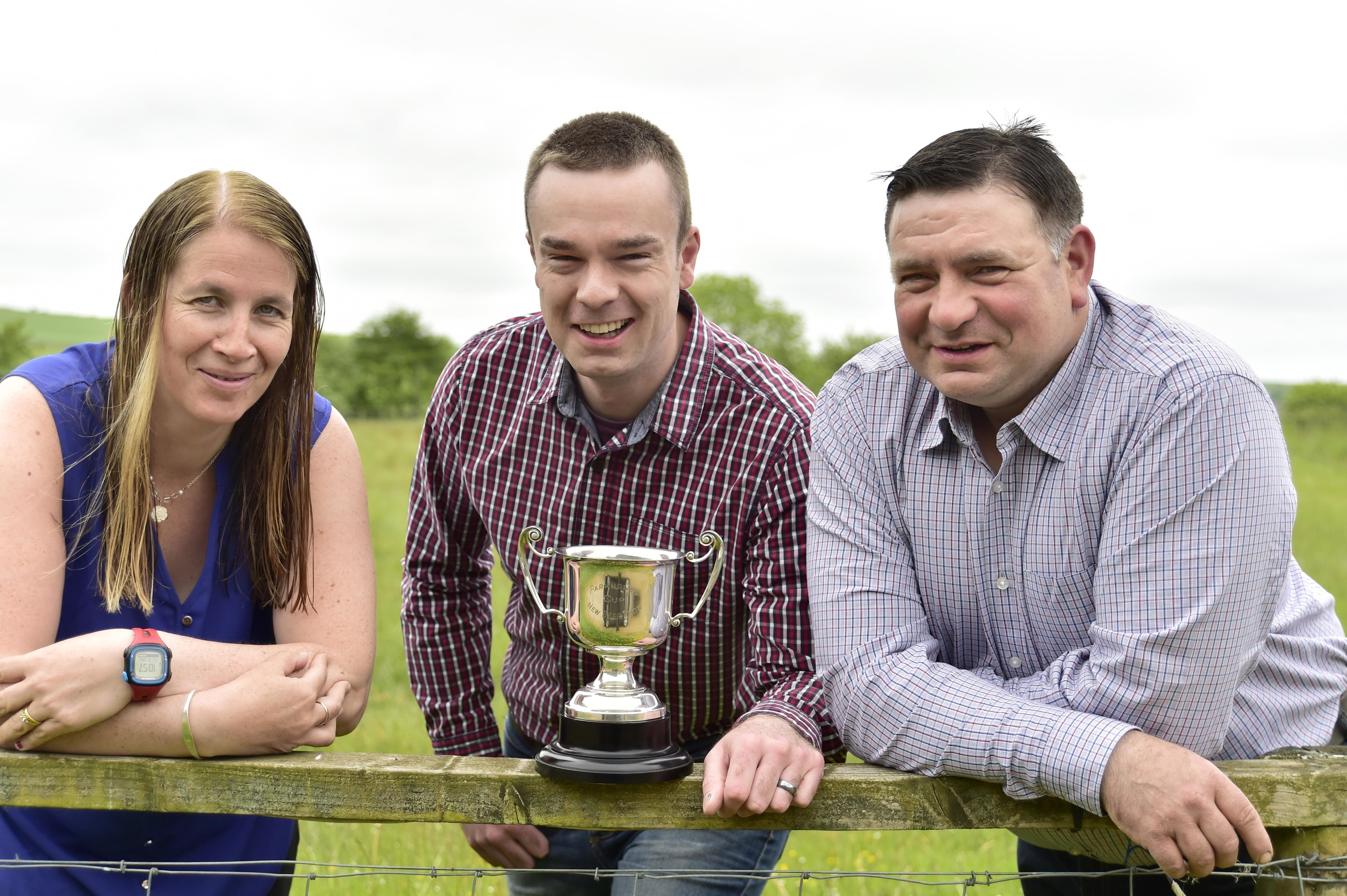 Antiques dealer Robert Cook (centre) with New Deer Show president Alistair Kindness and secretary Lynne Morrison and the Parkhouse Cup,  80 years after it vanished.
