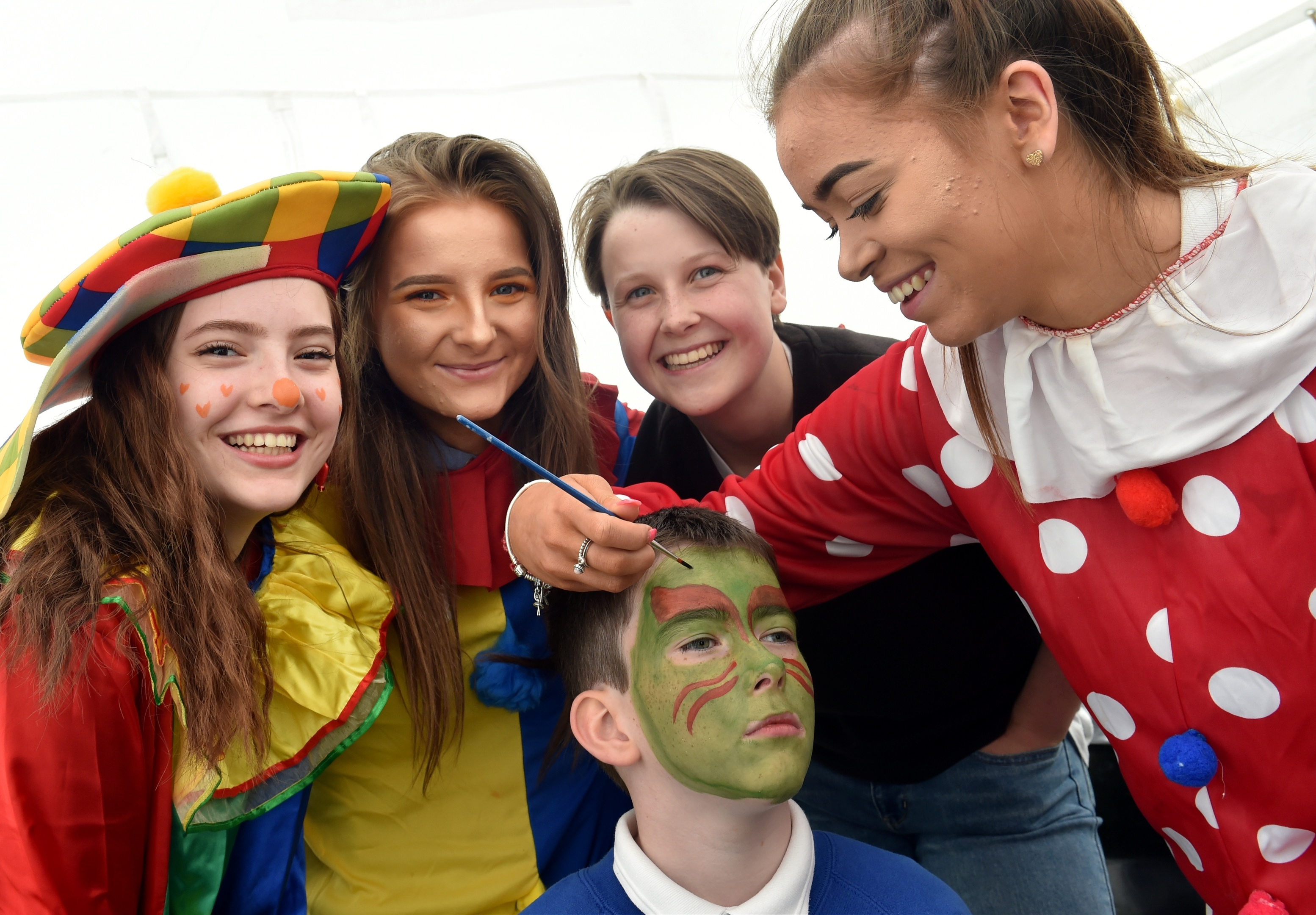 Rotary KidsOut was held at Craibstone. Declan Taylor 11 gets his face painted by (from left) Leire Hernandez, Heather Bowie, Cara Fyfe and Katie McDougall. Picture by COLIN RENNIE  June 13, 2018.