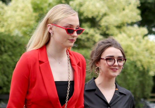 Actresses Sophie Turner (left) and Maisie Williams arrive at the wedding (Jane Barlow/PA Wire)
