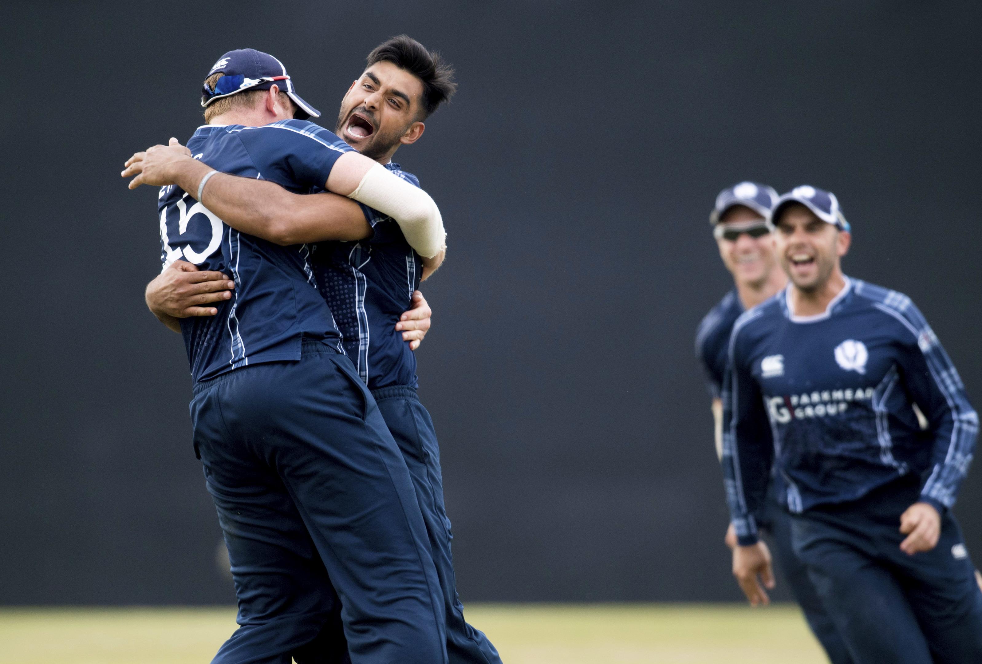 Scotland's Safyaan Sharif celebrates as Scotland win by six runs at The Grange in Edinburgh