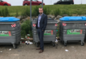 "SNP councillor Stephen Flynn standing at the ""disgusting"" recycling point in Cove"