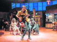 Tyler Collins rocks it up with the ensemble cast. The musical's themes are love, home and identity