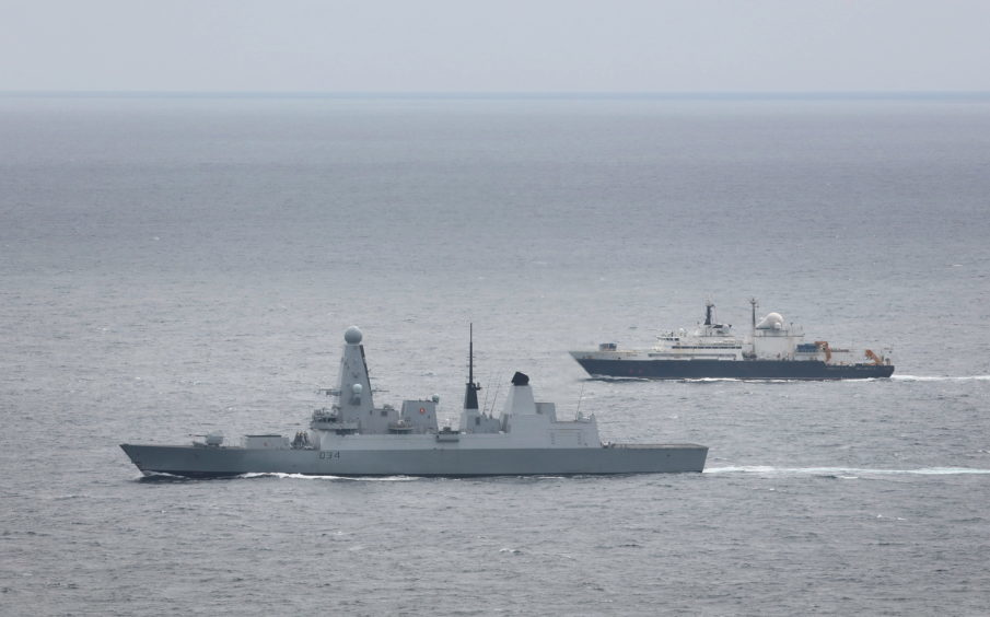 Image of Royal Navy ship HMS Diamond shadows a Russian Navy spy ship as it passes through the English Channel
