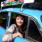 Laura Morrison, driving in her 1958 Morris Minor from Aberdeen to South Africa to raise money for cancer research.