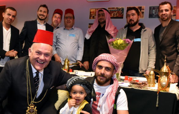 In the picture are Lord Provost Barney Crockett with Syrian people who hope to open a cafe in the city