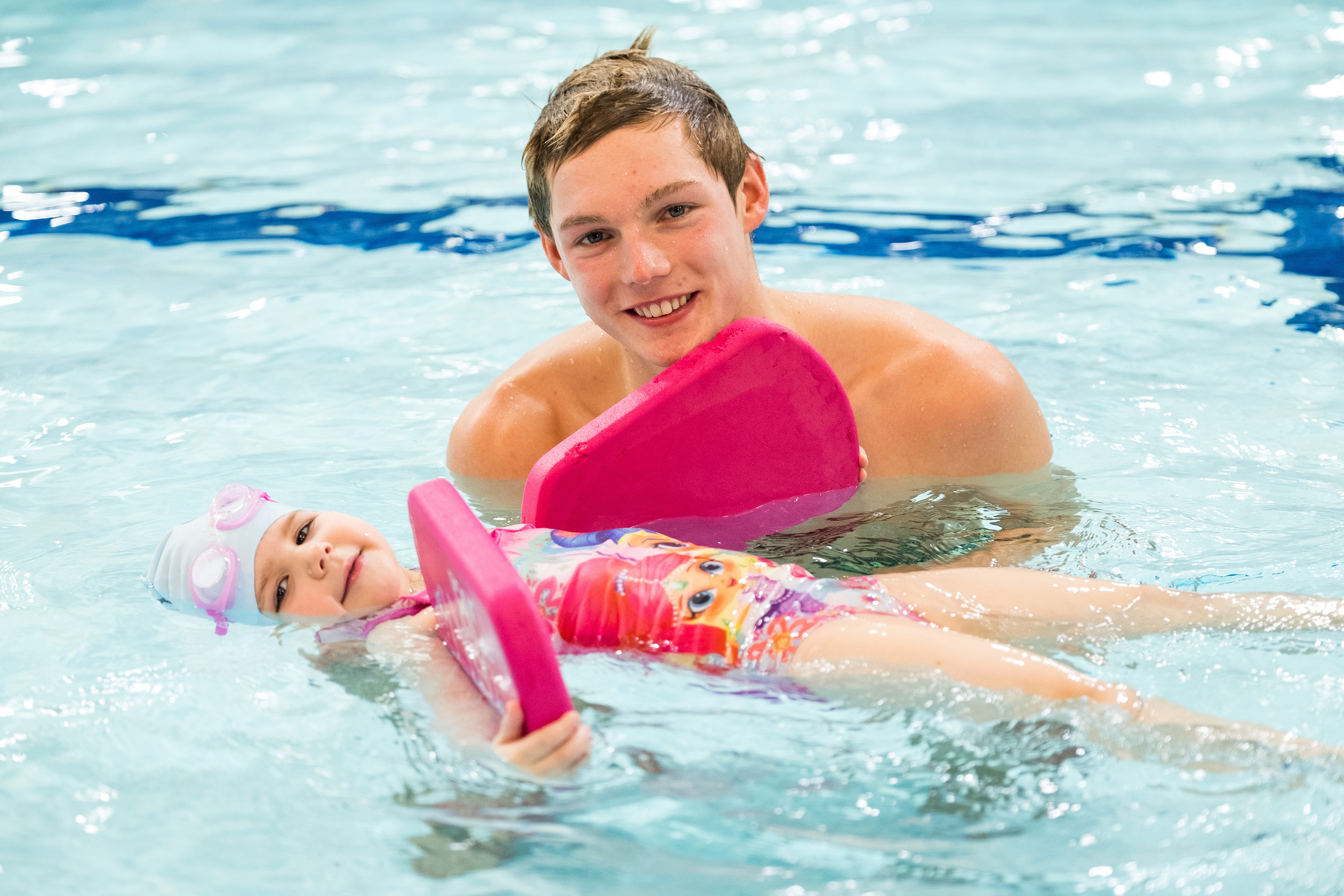 A young swimmer receives swimming lessons from Commonwealth athlete Duncan Scott