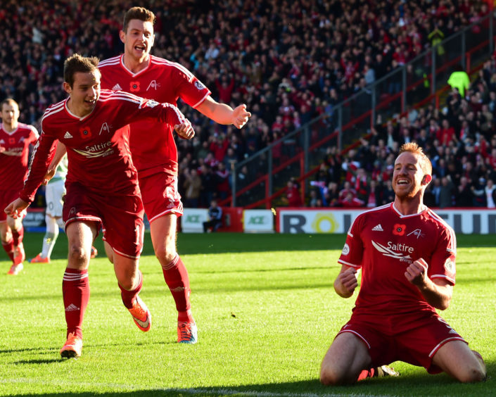 Adam Rooney (right) wheels away having put his side 1-0 to the good against Celtic in November 2014.