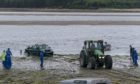 A local farmer had to use his tractor to free the Mitsubishi Shogun from the muddy sands at Findhorn Bay.