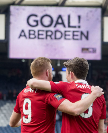 Rooney celebrating his Hampden opener with Ryan Christie.